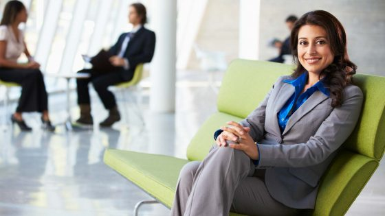 Post With Slider Portrait Of Businesswoman Sitting On Sofa In Modern Office 560x315