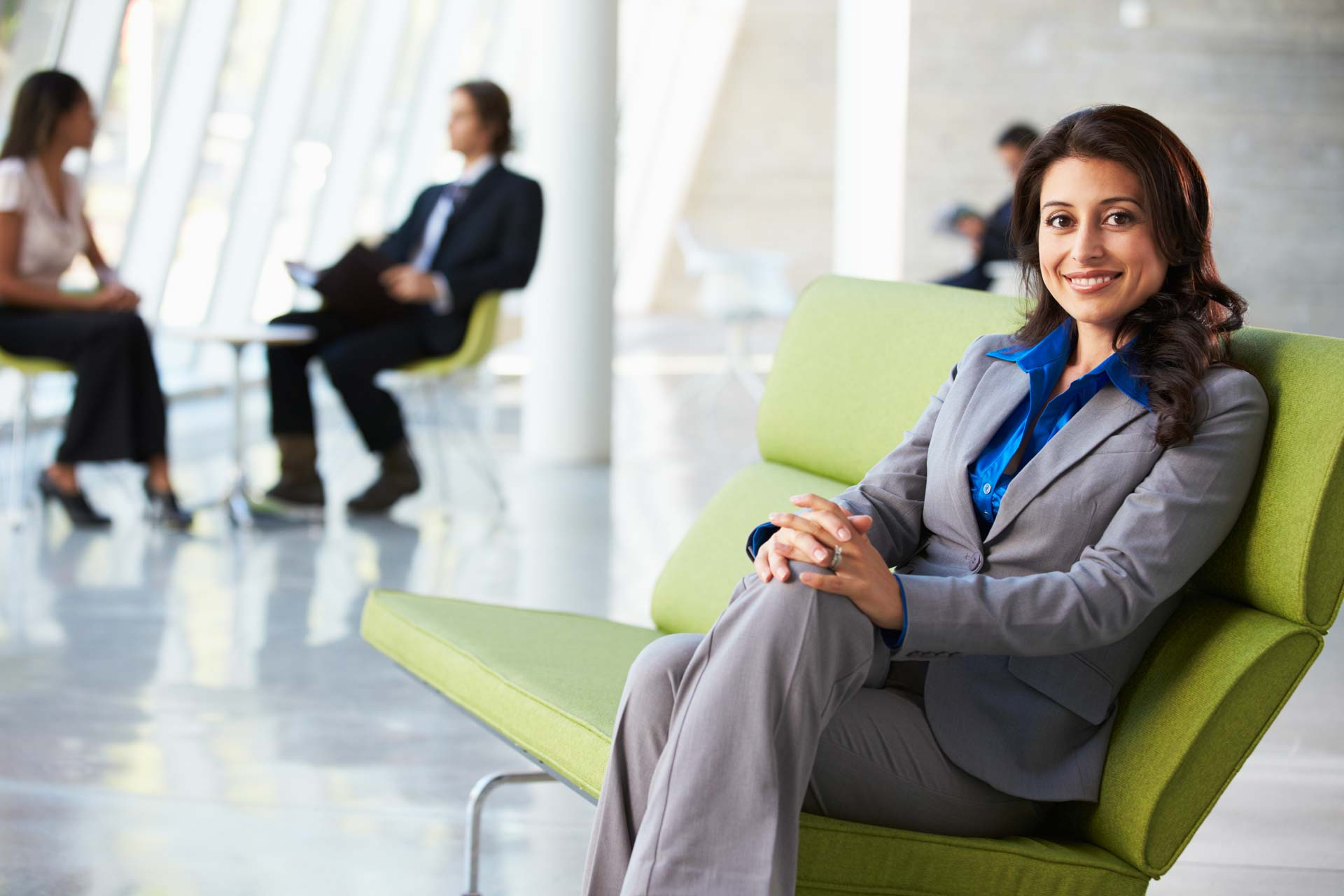 With Builder Portrait Of Businesswoman Sitting On Sofa In Modern Office